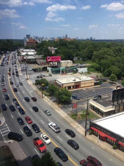 Traffic heading South on Peachtree at The Brookwood. Two points: importance of dining and services on site will continue to be important for condo dwellers and 2) view NE on Peachtree shows opportunities for future mixed-use development
